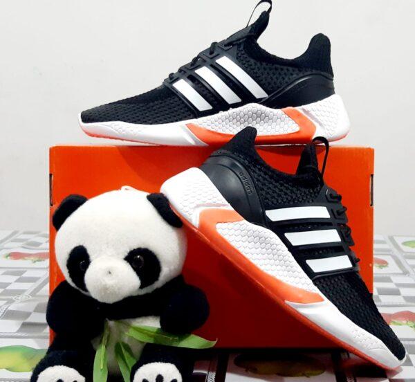 Zapatillas Nike Run Negro con Naranja